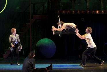 "Rehearsing ""Pippin,'' Olga Karmansky (left) looks on as Gregory Arsenal does a backward pike through a hoop and Orion Griffiths moves in to catch him."